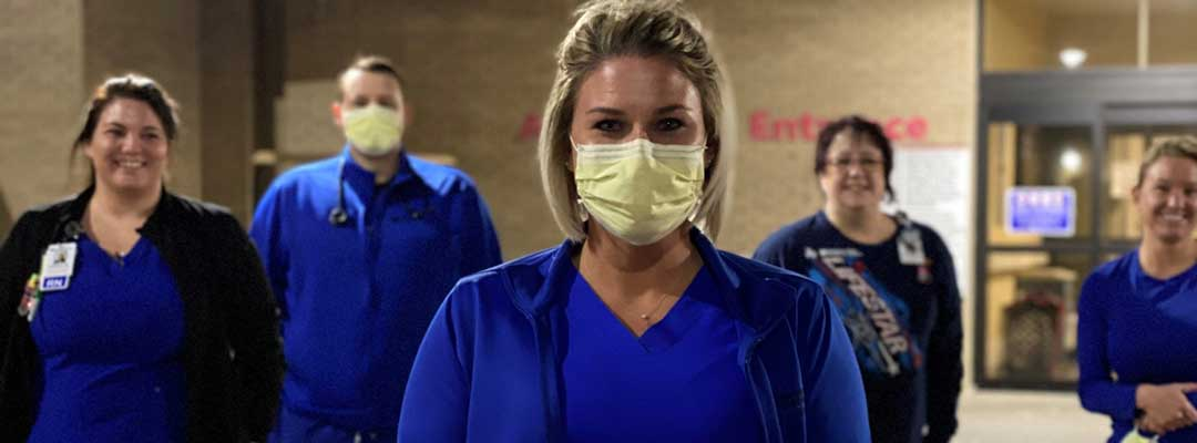 Northwest Texas Healthcare System Nurses wearing masks in front of hospital entrance